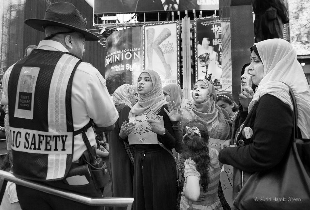 Confrontation Times Square, New York City © 2014 Harold Green.
