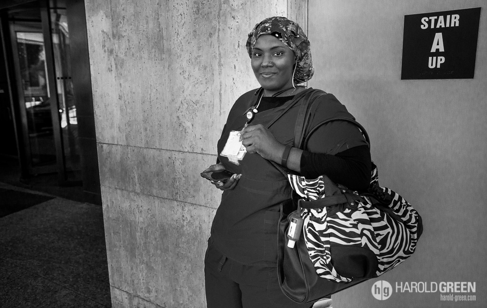 """Shift's End"" Houston, Texas © 2014 Harold Green. After a long day of caring for others, Trinette awaits her ride home."