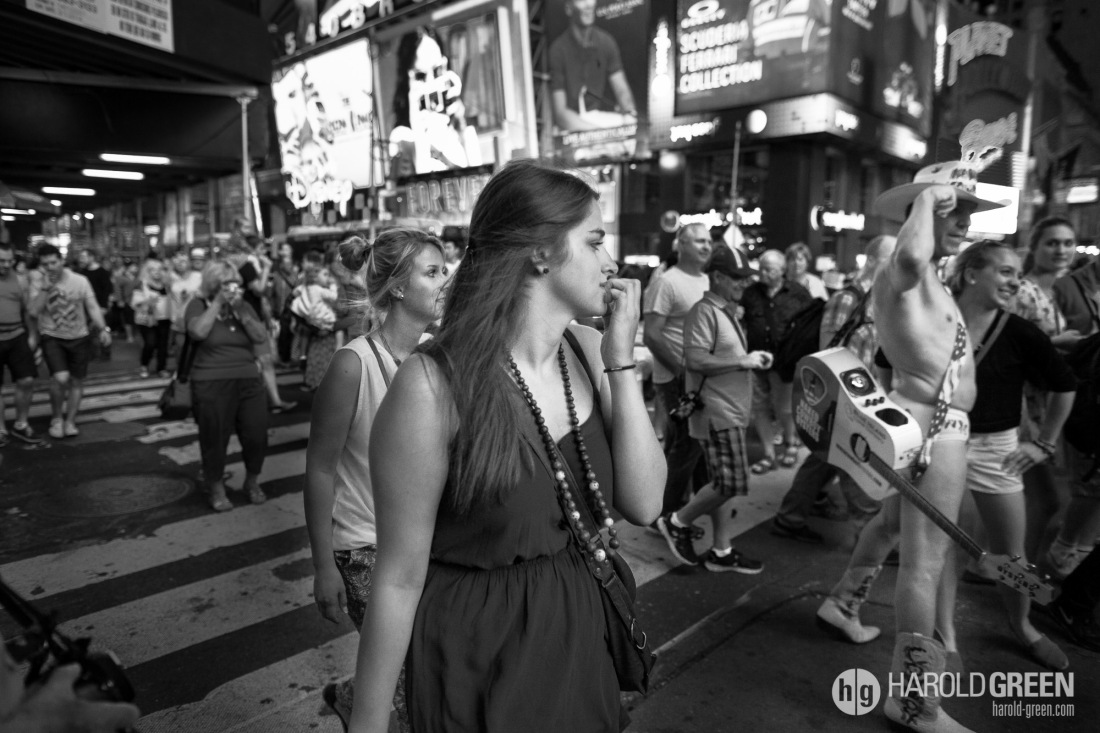 """Sneaking A Glance"" Times Square, New York City © 2014 Harold Green."